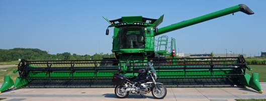 """Boxxer in the """"jaws"""" of S Model John Deere harvester at factory in Moline IL."""