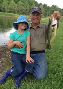 Clara very proud of the big bass she reeled in.