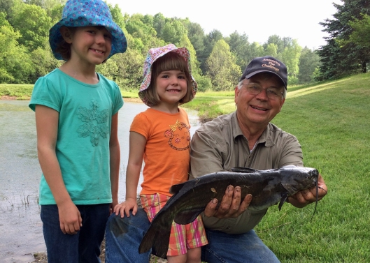 Helen (center) with the big catfish she landed.