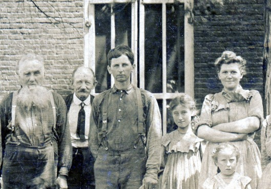 My Grandfather August (center) inherited the farm from his father William (far left). August's wife Catherine is pictured on far right.